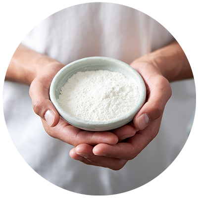 Coconut Flour ingredient being cradled in a bowl in hands, nothing artificial ever